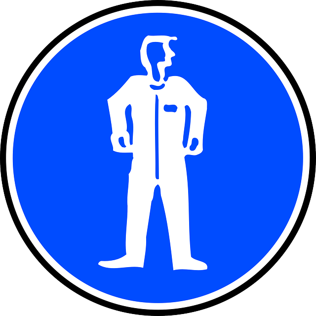 Proper signage, in this case reminding workers that safety suits are needed, are part of a strong workplace safety program.